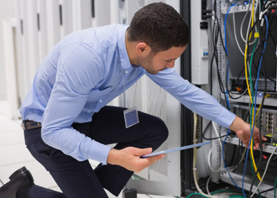 Technician Working on a Server